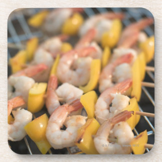 Skewer with grilled shrimps and pepper Sweden. Coaster