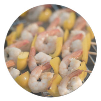 Skewer with grilled shrimps and pepper Sweden. Dinner Plate