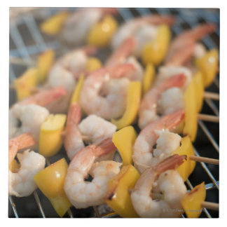 Skewer with grilled shrimps and pepper Sweden. Tile