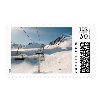 ski lift in sunny snowy landscape postage