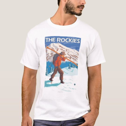 Skier Carrying Snow Skis - The Rockies T-Shirt