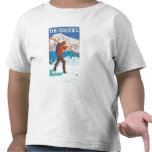 Skier Carrying Snow Skis - The Rockies Tee Shirts
