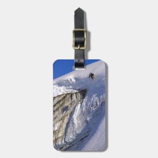 Skier jumping off Glacier wall in Greenland Travel Bag Tag