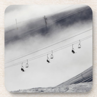 Skiers on a chair lift beverage coaster