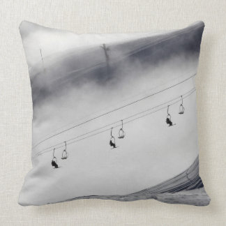 Skiers on a chair lift throw pillow