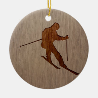 Skiing silhouette engraved on wood design ceramic ornament