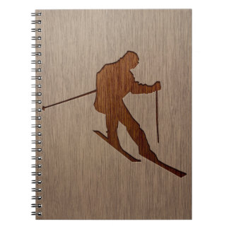 Skiing silhouette engraved on wood design spiral notebook
