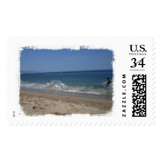 Skimboarders in the Surf Postage
