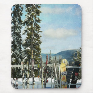 Skis and Snowboards on Mountain Top Mouse Pad