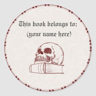 Skull and a book classic round sticker