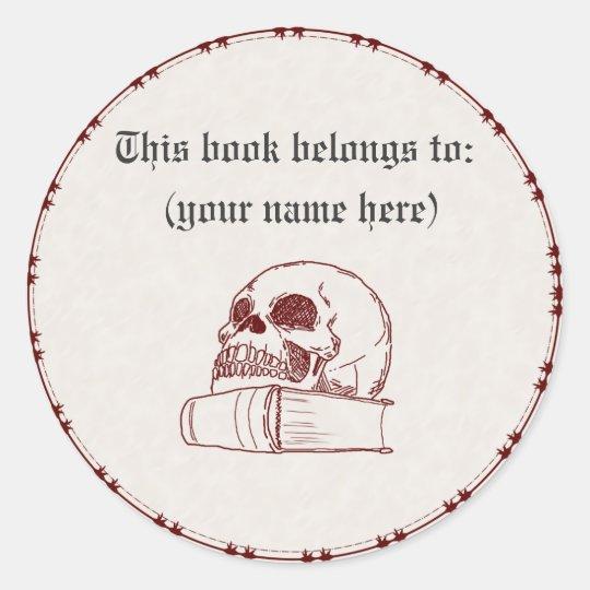 Skull and a book classic round sticker