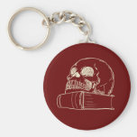 Skull and a book keychain