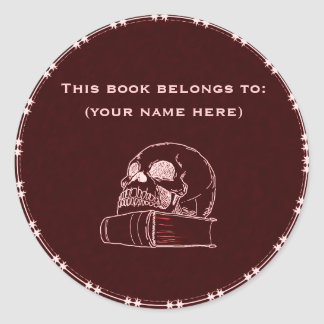 Skull and a book, red round sticker