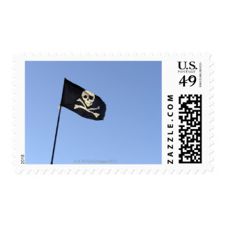 Skull and crossbones on Pirate's flag on blue Postage