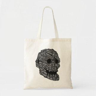Skull head stone skull rock tote bag