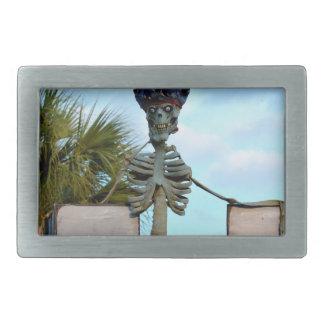 skull pirate skeleton statue over stone wall belt buckle