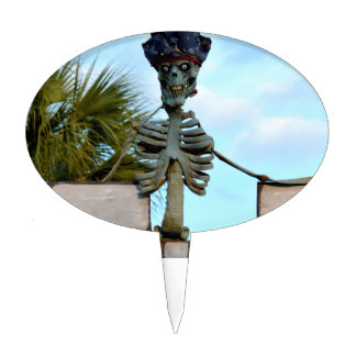 skull pirate skeleton statue over stone wall cake topper