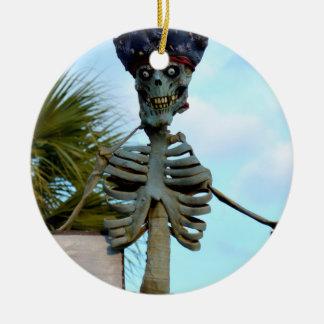 skull pirate skeleton statue over stone wall ceramic ornament