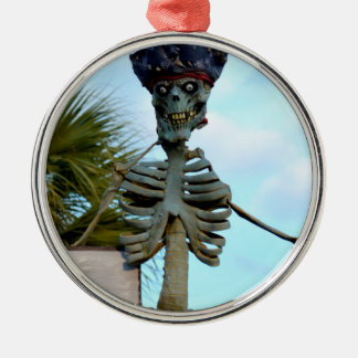skull pirate skeleton statue over stone wall metal ornament