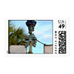 skull pirate skeleton statue over stone wall postage