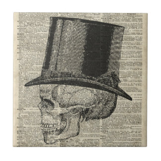 Skull with victorian hat stencil over old book pag ceramic tile