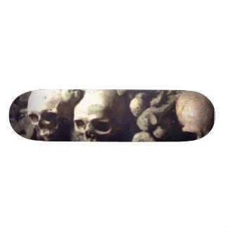 Skulls in a row skate deck