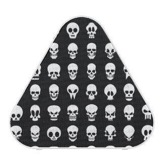 Skulls on black background bluetooth speaker