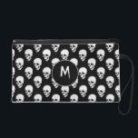 "Skulls pattern wristlet purse<br><div class=""desc"">This product has a pattern of white skulls on a black background</div>"