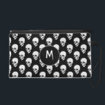 """Skulls pattern wristlet purse<br><div class=""""desc"""">This product has a pattern of white skulls on a black background</div>"""
