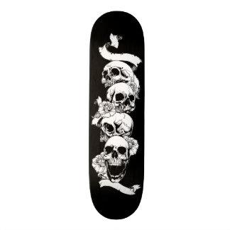 Skulls tattoo skateboard