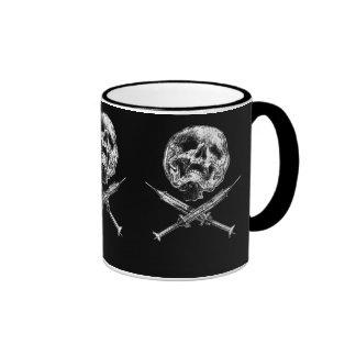 Skulsl y jeringuillas tazas de café