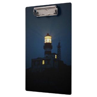 Sky Themed, An Illuminated Light Tower Located Beh Clipboards
