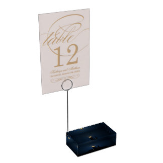 Sky Themed, An Illuminated Light Tower Located Beh Table Card Holders