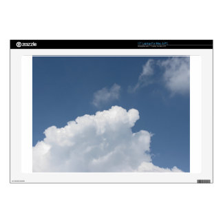 Sky with giants clouds and sun rays through laptop skin