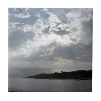 Sky with giants cumulonimbus clouds and silhouette ceramic tile