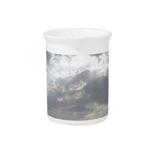 Sky with giants cumulonimbus clouds and silhouette drink pitcher