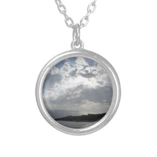 Sky with giants cumulonimbus clouds and silhouette silver plated necklace