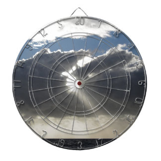 Sky with giants cumulonimbus clouds and sun rays dart board