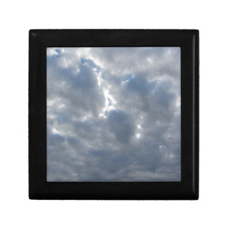 Sky with giants cumulonimbus clouds and sun rays gift box