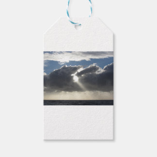 Sky with giants cumulonimbus clouds and sun rays gift tags