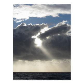 Sky with giants cumulonimbus clouds and sun rays postcard