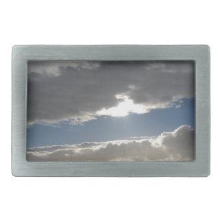 Sky with giants cumulonimbus clouds and sun rays rectangular belt buckle