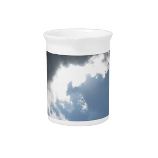 Sky with giants cumulonimbus clouds and sun rays t drink pitchers