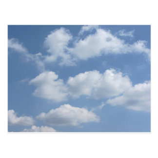 Sky with giants cumulonimbus clouds and sun rays t postcard
