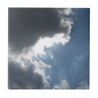 Sky with giants cumulonimbus clouds and sun rays t tile