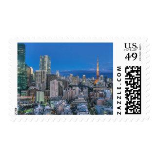 Skyline at twilight stamp