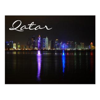 Skyline of Doha, Qatar at night text postcard