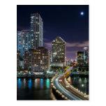 Skyline of Miami city with bridge at night Post Card