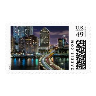 Skyline of Miami city with bridge at night Stamp