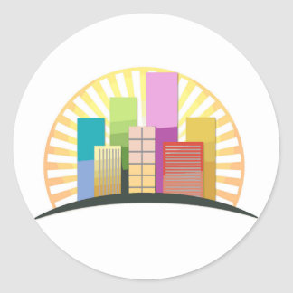 Skyscrapers and sun showing a urban city classic round sticker